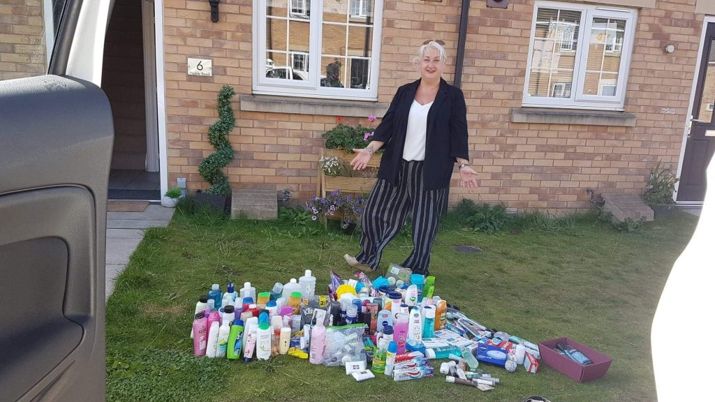 Tracey Dubinsky stood with her donations